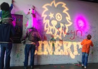 Cinekid image with kids drawing on wall